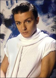Yes, this is comedian and actor Ricky Gervais in 1983 when he sang in a British band.