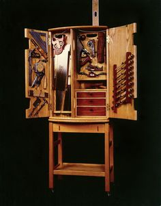 Tool chest is 60 inches high, 22 inches wide and 15 inches deep. The doors are curved, or coopered.