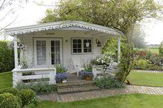 Pretty white garden house