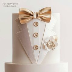 Wedding Cakes by De La Crème Creative Studio ~ Groom's cake is an all white tux with satin-faced lapels, gold bow tie and buttons with boutonniere with gold leaf centers. Fancy Cakes, Cute Cakes, Pretty Cakes, Beautiful Cakes, Amazing Cakes, Pink Cakes, Fondant Cakes, Cupcake Cakes, Fondant Bow