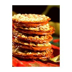 Milk Chocolate Florentines Cookies - These thin, chocolate-filled sandwich cookies make elegant holiday gifts, wrapped in a festive package. Serve them with a fruit sorbet or your favorite gourmet ice cream. Cookie Recipes, Dessert Recipes, Desserts, Yummy Recipes, Recipies, Holiday Baking, Christmas Baking, Christmas Cookies, Cookies