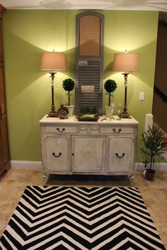 chevron rug from HomeGoods adds style to this green kitchen