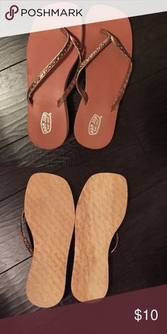 Ron Jon Surf Shop Sandals Bronze color sandals. From Ron Jon Surf Shop in Florida. Worn in the house only. I don't see a size but they should be a 7/8 or medium. Shoes Sandals