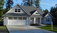 Small, Craftsman home with gray and white exterior! The Landry Plan 1291. See the floor plan here: http://www.dongardner.com/plan_details.aspx?pid=4392 #SmallHouse #Craftsman #HomeDesign
