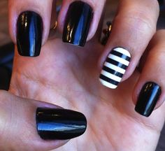 Black nails with black and white striped accent.