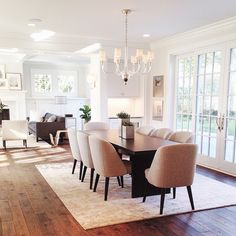 Love this classic meets casual modern dining room from the Parade of Homes in Edina. This photo, that I snapped, captured the beauty of this house perfectly. From the built-ins to the ceiling detail to the hard wood floors, this home was stunning. It's mostly furnished by @roomandboard and I love that store! #diningroom #interiors