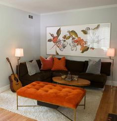 gray walls, brown couch, and pops of color. exactly what my living room is heading towards :) only with blue/green as the pop.