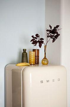 ivory smeg refridgerator with mustard yellow vases. / sfgirlbybay