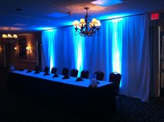 navy blue uplighting & curtains from www.erieuplighting.com