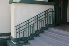 This railing was added later as a safety feature to the building. It could not be attached to the wall because it would change the original structure. So it was anchored to the stairs. Exterior Stair Railing, Outdoor Stair Railing, Balcony Railing Design, Fence Design, Commercial Interior Design, Office Interior Design, Rambler Remodel, Frank Lloyd Wright Style, Metal Handrails