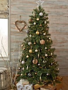 Add a sense of glamour to your Christmas decorations but incorporating gold and silver tones