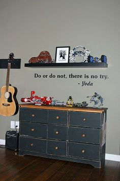 Like the quote for the boys room.  And, if they ever talk me into letting them re-paint, this is a classic boy look (Star Wars, charcoal grey, add some red?)