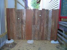 rustic jarrah gates with marbles..