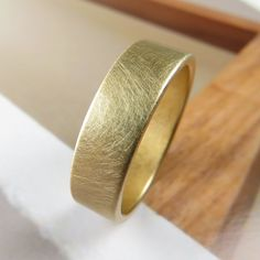 Brushed 6MM wide handmade wedding band in 14k yellow gold by Spexton.  Spexton gold bands are seamless, stronger than ordinary wedding bands. Love the unique finish of this ring.