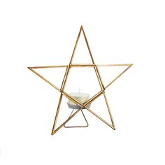 Brass Star Tea Light Holder: This unique antique brass star serves as a striking tea light holder and decorative piece. The holder features brass edges, pannelled glass with a standing holder for the tea light. The glow of the tea light, when lit, will look even more mesmerising behind the glass.A warming and striking addition to your home over the winter months and beyond.