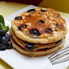 Move over boxed mix! Try my Healthier Greek Yogurt Blueberry Pancakes recipe. Hi guys! Weekends mean one thing in my house.... pancakes! Hardly a weekend goes by without a stack of the good stuff. Usually the Hubs is in