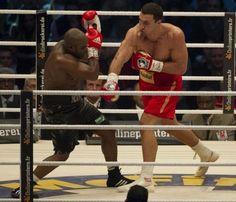 Ukrainian heavyweight boxing world champion Wladimir Klitschko (R) fights with French challenger Jean-Marc Mormeck