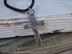Rustic cross necklace in sterling silver on black leather cord with a hand forged hook clasp, mens or womens jewelry $65.00 by JoDeneMoneuseJewelry