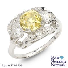 Estate Yellow Diamond engagement ring. Discover Gemstones and stunning jewelry from every era, vintage diamond rings, Art Deco blue sapphire earrings, estate emerald bracelets, ruby necklaces and more! Tune in to Gem Shopping Network to see more stunning Gemstones & Jewelry 24/7.   Item #398-1516 Estate 1.71 ct Fancy Intense Yellow Diamond Old Mine Cut & 0.50 ctw White Diamond Old Mine Cut 14K White Gold Ring GIA Lab Report W/ Appraisal Approx.Wt. Size 5.5