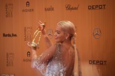 Huge honour: Rita won the Music International Award on the night, and happily held it alof...