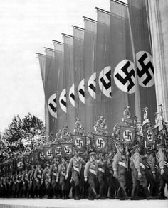 """Nazi march, probably at Neurenburg, from Leni Reifenshahl's """"Triumph of the Will"""". This movie was banned by the US because it was feared the ultimate and perfect propaganda would make the Germans seem invincible or might convince American citizens the Germans were in the right. It was feared it would totally demoralize the average citizen. To this day, the movie is considered the greatest propaganda movie of all time."""