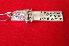 Follow Your Dreams handstamped aluminum personalized drop pendant necklace or keychain with solid ice skate charm. $20.00, via Etsy.