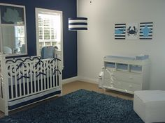 navy blue nursery... Even for a girl... Add hot pink detail and its done!