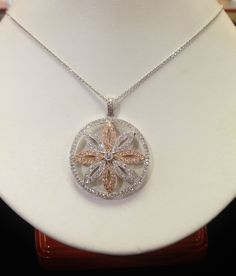 This pretty rose and white gold diamond flower medallion pendant is part of Becker's HUGE Estate JEwelry Department!