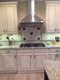 Benjamin Moore Natural Wicker with Charcoal Glaze. Painted the original Cabinet Hardware with Rustoleum Metallic Oil Rubbed Bronze, Zephyr Europa Vent Hood and Kitchen Aid 5 Burner Gas Cooktop