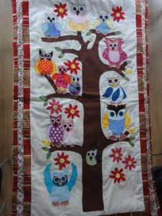 Family Tree is a patchwork Wall Hanging with 13 owls appliques