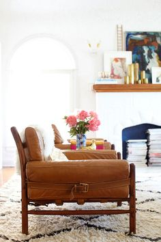 Grey + Scout | Brown bucked seats + pink flowers on a Moroccan rug