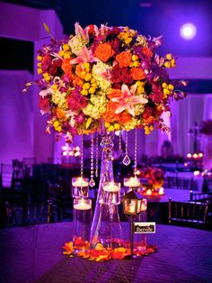 I love all the candles nested around the base of the large arrangement.  You can never have too many candles!!