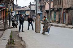 Kashmiri boys play cricket on an empty road during a day-long strike in Srinagar, India, February (Mukhtar Khan/AP)