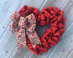 Heart Wreath, Valentines Day Wreath, Greenery Wreath, Primitive Country Wreath, Everyday Wreath Artificial greenery/ eucalyptus wreath on a grapevine with large berries, pussy willows, moss finished with a burlap fabric heart and bow. Wreath dimensions are: 21 inches in diameter - 5.5 inches deep.