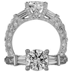 Romantique diamond engagement ring featuring a round cut center and baguette side diamonds. This engagement ring features the finest set micropavé and bezel set diamonds on the setting. The shank and the mounting features a microscopic hand carved leaf motif.