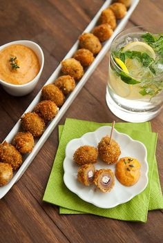 Inspired by a dish at Black Bottle in Seattle, these Fried Stuffed Olives are filled with an herbed goat cheese before being rolled in panko bread crumbs. They're served with a spicy remoulade sauce.