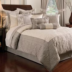 Master bedroom bedding...maybe with purple accents and black furniture