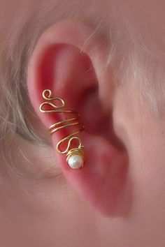 So pretty. Ear cuff with pearls. ($25.00)  By: thelazyleopard at Etsy.com