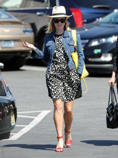 Reese Witherspoon wearing Current/Elliott The Snap Denim Jacket Elizabeth and James Embossed Python Cynnie Sling bag in Lemon Zest
