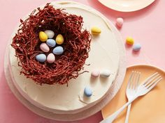 Recipe of the Day: A Chocolate Nest to Top Your Cake Hey, we would have never left the nest if we knew it was made out of chocolate. Perched on top of a fluffy chocolate cake, this edible nest lookalike is all chocolate and crunchy noodles, and it's the perfect place to lay candy-coated chocolate eggs.