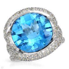 Topaz cocktail ring with genuine diamonds.
