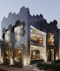 This honeycomb inspired facade, full of hexagonal shapes, was created for the Estar Móveis shop in São Paulo, Brazil.