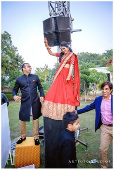 Indian Wedding Photography - Bride in a Red Lehenga dancing on Top of a Speaker | WedMeGood #indianbride #indianwedding #lehenga #bride #red