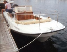 ribbed  1970 Outrage 21 at dock, bow view