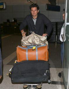 Orlando Bloom Photos - Orlando Bloom Arrives at LAX Airport - Zimbio