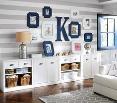Sawyer Storage #pbkids  Love the wall frames would save some frames for 1st day home, 1 month, 3 months, 6 months, 9 month & 1 year photos!