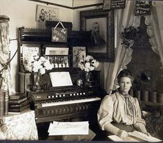 Victorian parlor scene, Weaver reed organ, lovely lady.