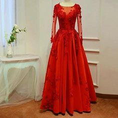 Red long sleeve ball gowns are nice for the mothers of the wedding. We are dress designers who create totally custom #motherofthebridedresses that you can customize. We can also use pictures of haute couture #eveningdresses as inspiration to make you a #replicadress that looks similar but cost much less. Get pricing on any dress whennyou you contact us at www.dariuscordell.com/