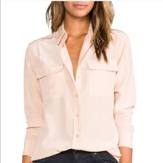 Nude silk Equipment top size Small button down Equipment silk button down top - size Small - I just realized I didn't button one of the buttons but it is not missing!  Equally great with black wax coated jeans or white ripped skinnys and flip flops.  Excellent condition Retail $298 Equipment Tops Button Down Shirts