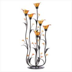 Slender curving stems support iridescent amber lily blossoms, creating an elegant play of form and color. Place a candle into each bloom to enhance the night with dazzling light!